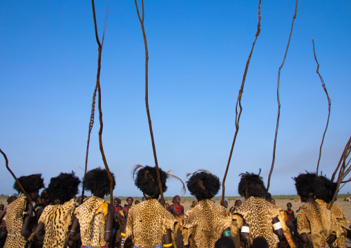 Dassanech men with leopard skins and ostrich feathers wigs during Dimi ceremony to celebrate circumcision of teenagers, Turkana County, Omorate, Ethiopia