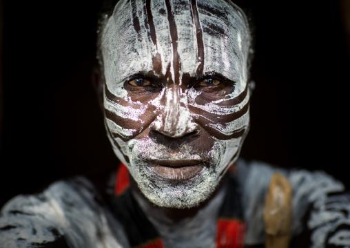 Portrait of Karo tribe man white painted face, Omo valley, Korcho, Ethiopia