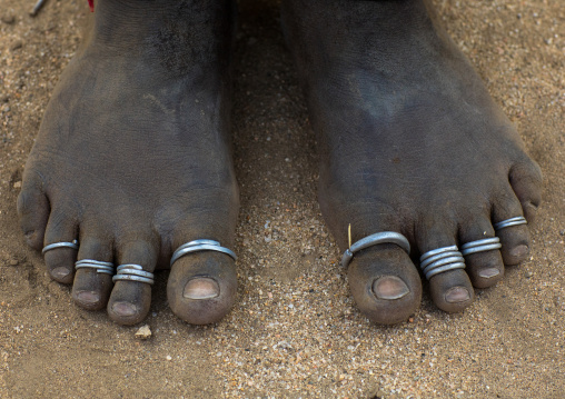 Feet with rings of an Erbore tribe woman, Omo valley, Murale, Ethiopia