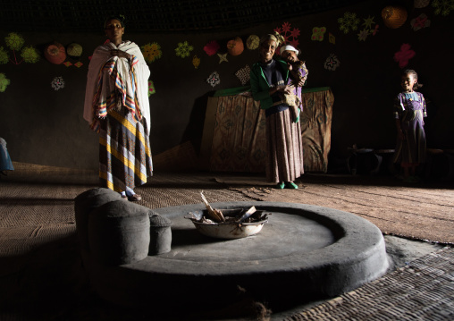 Gurage family inside their traditional house decorated with doilies on the walls, Gurage Zone, Butajira, Ethiopia