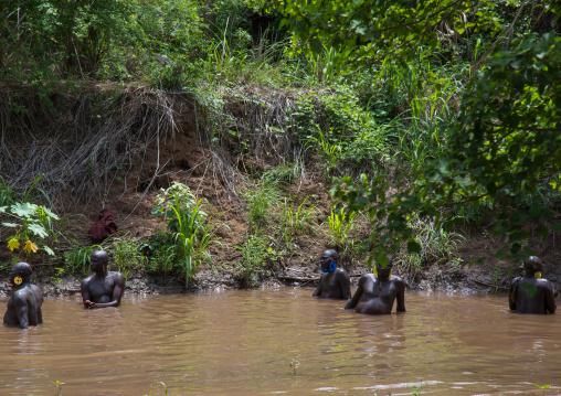 Bodi tribe fat men taking a bath before the Kael ceremony, Omo valley, Hana Mursi, Ethiopia