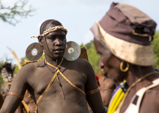 Bodi tribe fat man with a dvd as earrings during Kael ceremony, Omo valley, Hana Mursi, Ethiopia