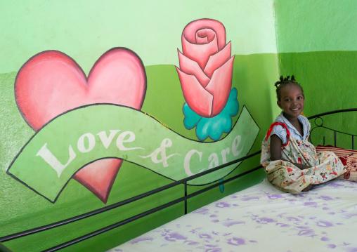 Mingi girl in her bedroom in Omo child foundation, Omo valley, Jinka, Ethiopia