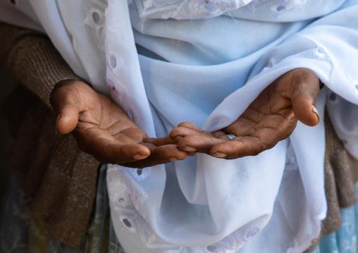 Hands of an ethiopian muslim woman praying, Harari Region, Harar, Ethiopia