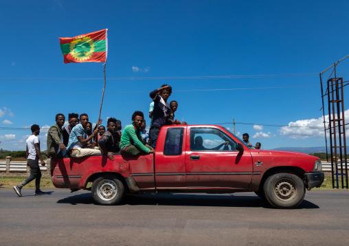 Men in a car celebrating the oromo liberation front party, Oromia, Waliso, Ethiopia
