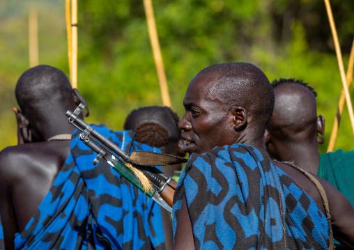 Suri tribe warriors during a donga stick fighting ritual, Omo valley, Kibish, Ethiopia