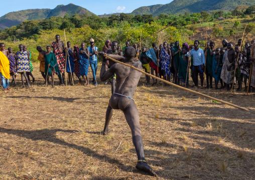 Suri tribe warriors fighting during a donga stick ritual, Omo valley, Kibish, Ethiopia