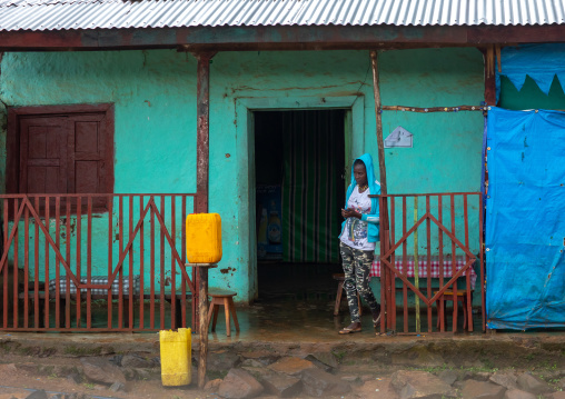 Ethiopian woman standing at the entrance of a bar, Bench Maji, Mizan Teferi, Ethiopia