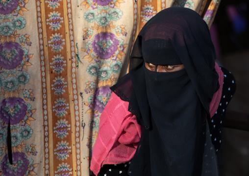 Oromo woman wearing a burqa in the market, Amhara region, Senbete, Ethiopia
