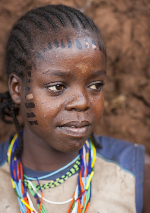 Girl from menit tribe with facial tattoos, Jemu, Omo valley, Ethiopia