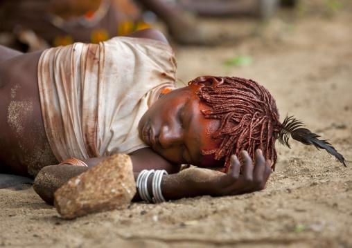 Young Hamar Tribe Girl Sleeping At A Bull Jumping Ceremony, Turmi, Omo Valley, Ethiopia