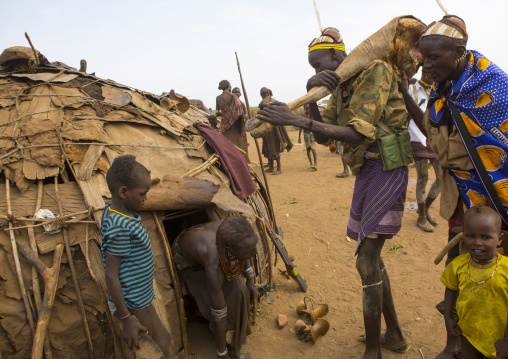 Dassanech Tribe Man Bringing Back Home Cow Meat During A Ceremony, Omorate, Omo Valley, Ethiopia