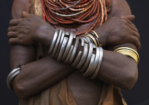 Detail Of Karo Woman Chest Wearing Metal Bracelets And Beaded Necklaces, Crossed Arms Omo Valley Ethiopia