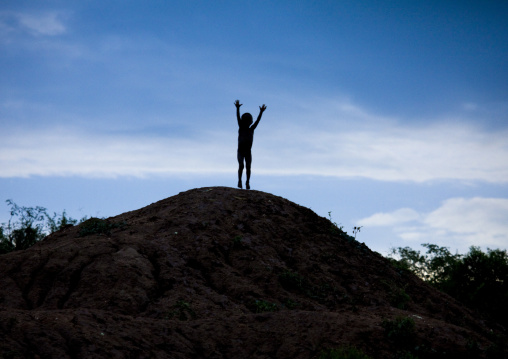 Banna Tribe Kid Jumping On A Hill, Omo Valley, Ethiopia