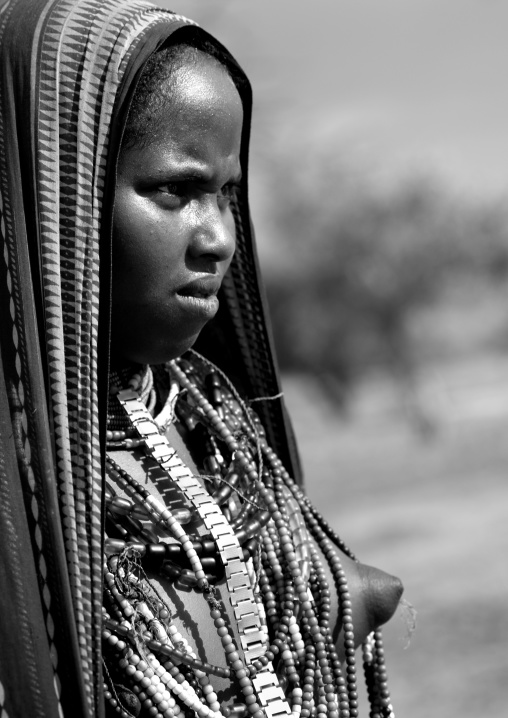 Arbore Tribe Tennage Girl With Naked Breast And Beaded Necklace, Omo Valley, Ethiopia