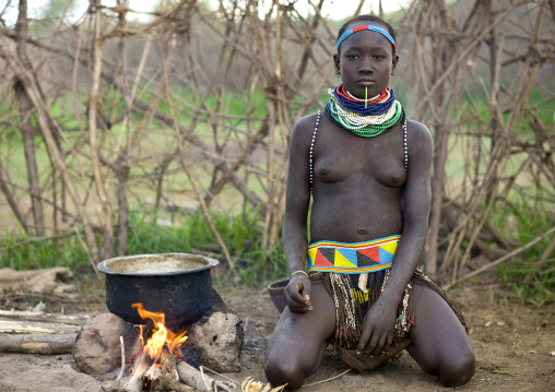 Portrait Of A Nyangatom Tribe Woman Preparing A Meal, Omo Valley, Kangate, Ethiopia