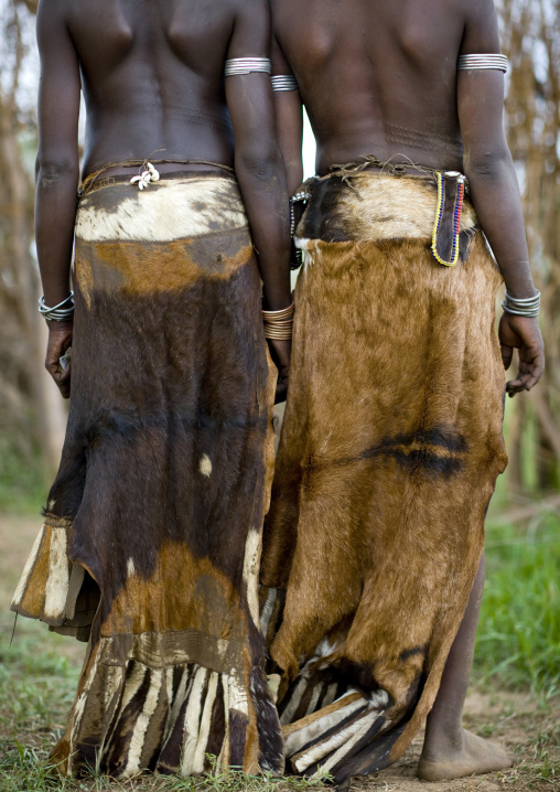 Rear View Of Nyangatom Tribe Women With Traditional Leather Skirts, Omo Valley, Kangate, Ethiopia