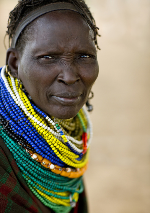 Portrait Of A Nyangatom Tribe Woman With Huge And Colourful Necklaces, Omo Valley, Kangate, Ethiopia