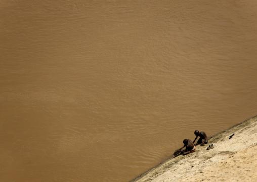 Aerial View Of Karo Kids Washing In Omo River, Korcho Village, Ethiopia