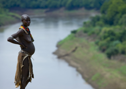 Portrait Of A Pregnant Woman From Karo Tribe Over The Omo River, Korcho Village, Omo Valley, Ethiopia