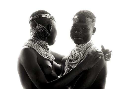 Black And White Portrait Of Two Embraced Karo Tribe Women, Korcho Village, Omo Valley, Ethiopia