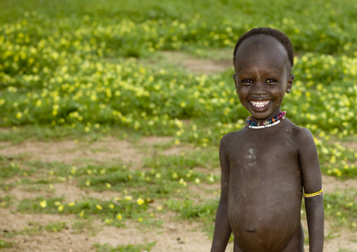Portrait Of A Kid From Karo Tribe With Toothy Smile, Korcho Village, Omo Valley, Ethiopia