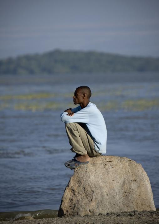 Oromo Man Sitting Alone On A Rock, Chamo Lake, Ethiopia
