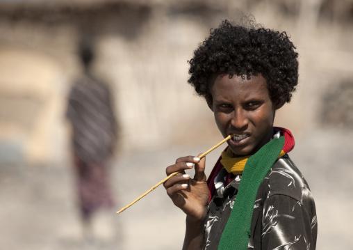 Afar man with  traditional toothbrush, Assaita, Afar regional state, Ethiopia
