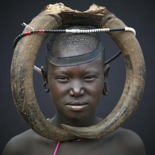 A Mursi Woman With Buffalo Horns Headdress, Omo Valley, Ethiopia