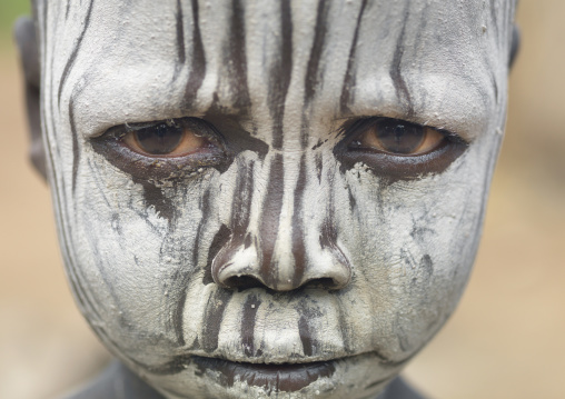Mursi Young Boy With White Painted Face And A Serious Look, Omo Valley, Ethiopia