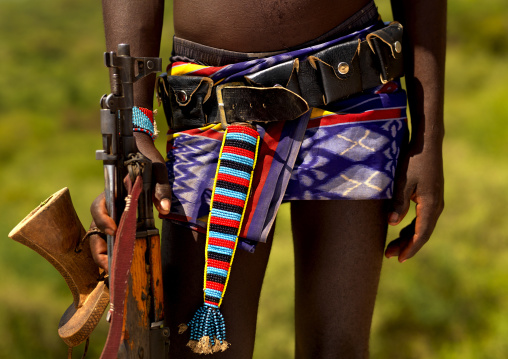 Detail Of The Belt Of A Banna Tribe Warrior With Headrest And Kalashnikov, Omo Valley, Ethiopia