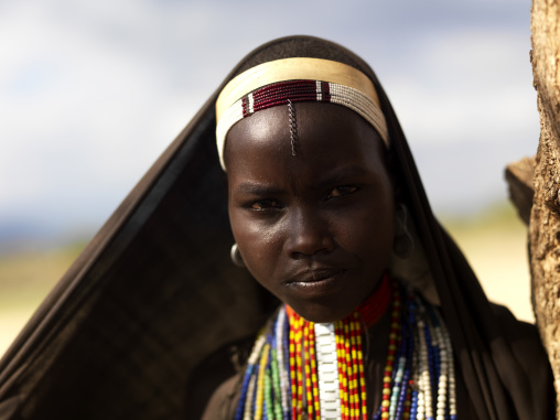 Portrait Of Arbore Tribe Teenage Girl Veiled With Necklaces, Omo Valley, Ethiopia