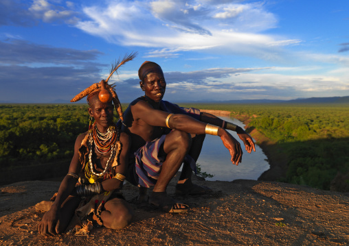 Portrait Of A Couple From Karo Tribe Over The Omo River At Sunset, Korcho Village, Ethiopia
