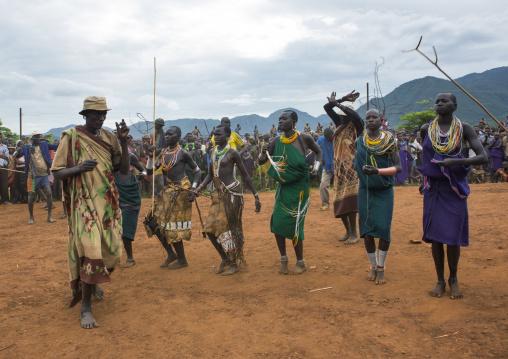 Suri tribe people dancing at a ceremony, Kibish, Omo valley, Ethiopia