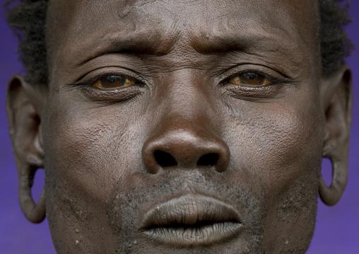 Suri tribe man with enlarged earlobes, Kibish, Omo valley, Ethiopia