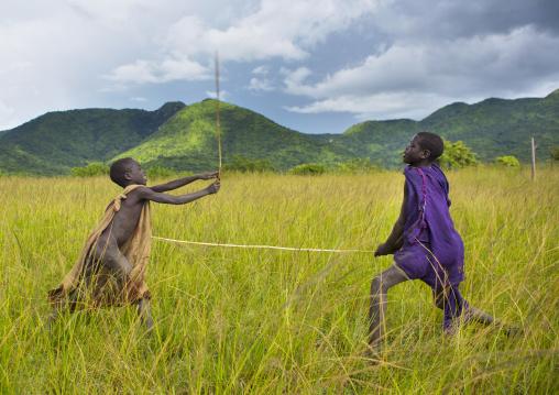 Children making a donga stick fighting in Suri tribe, Tulgit, Omo valley, Ethiopia