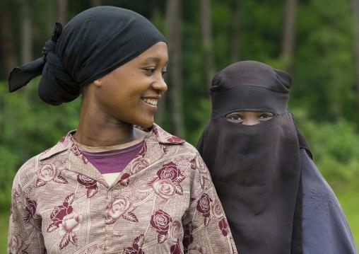 Two women smiling, Adama, Omo valley, Ethiopia
