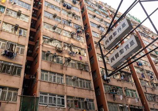 Facades of old apartments towesr in a very crowded district, Special Administrative Region of the People's Republic of China, Hong Kong, China