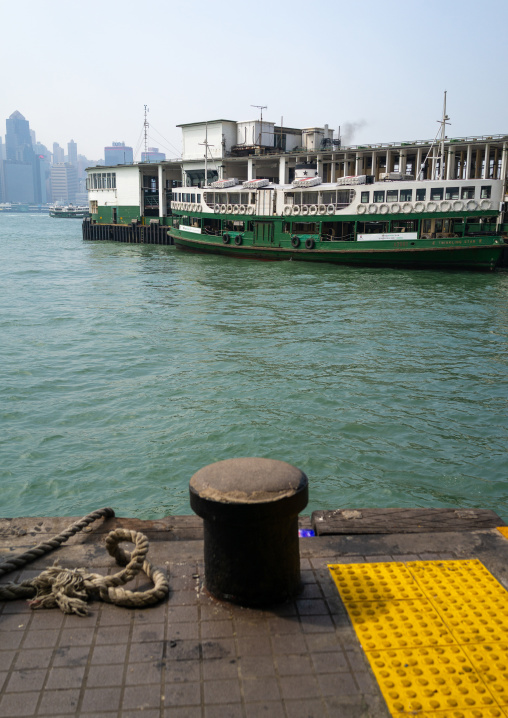 A star ferry leaving its Tsim Sha Tsui pier in kowloon to reach the central pier, Kowloon, Hong Kong, China
