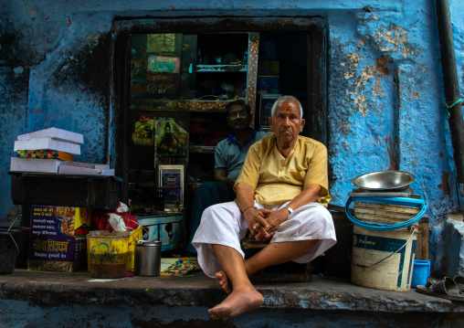 Indian man in front of his shop in the street, Rajasthan, Jodhpur, India