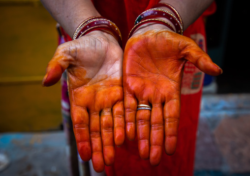 Cropped hands of woman showing henna tattoo, Rajasthan, Jodhpur, India