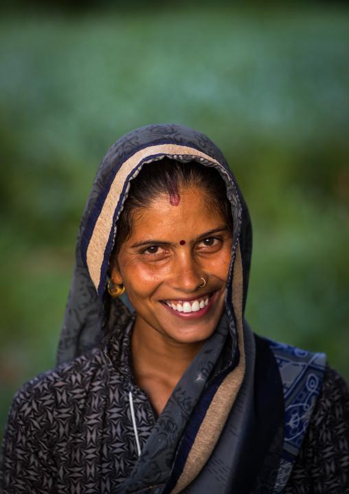 Portrait of a smiling rajasthani woman in traditional sari, Rajasthan, Baswa, India