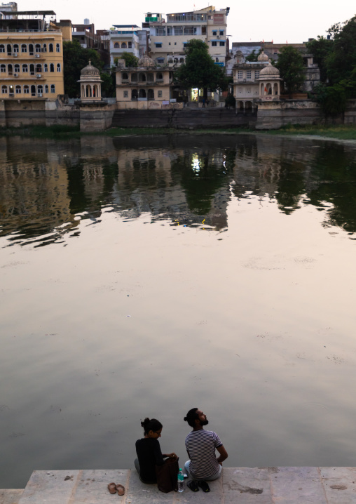 Couple sit on Gangaur ghat, Rajasthan, Udaipur, India