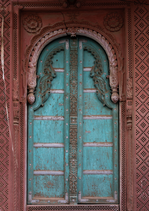 Beautiful blue wooden door of a haveli in the old city, Rajasthan, Bikaner, India