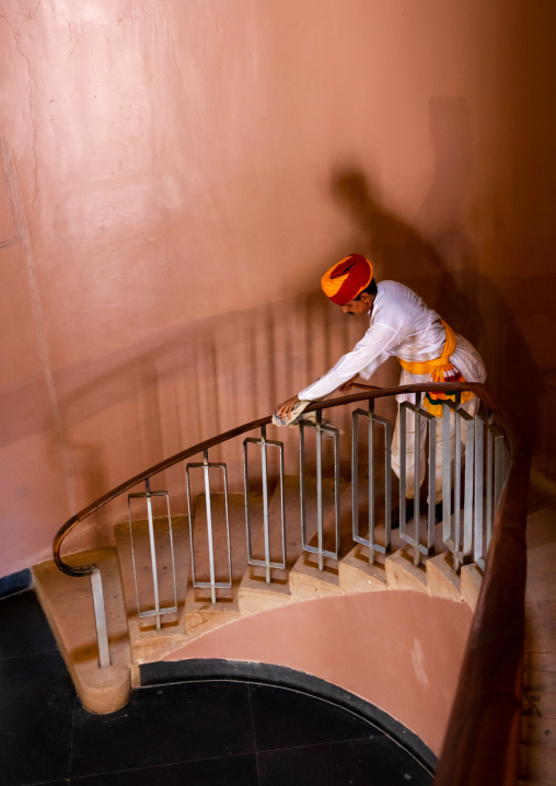 Portrait of a rajasthani man in traditional clothing cleaning stairs, Rajasthan, Jodhpur, India