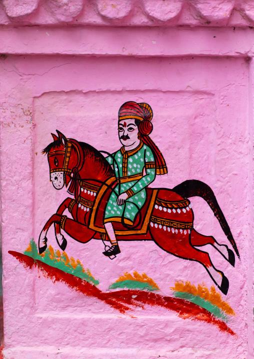 Murals depicting a horseman on a pink haveli, Rajasthan, Bundi, India