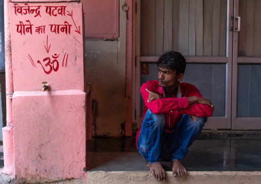 Portrait of an indian man squatting in the street, Rajasthan, Jaipur, India