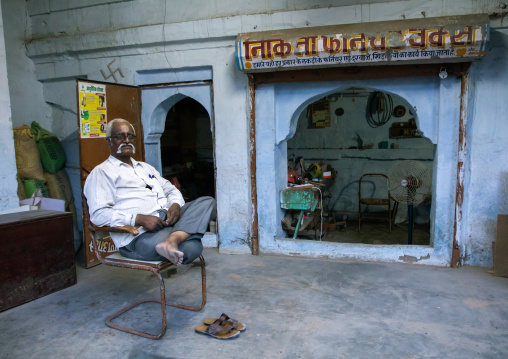 Indian man sit in front of his old house, Rajasthan, Jodhpur, India
