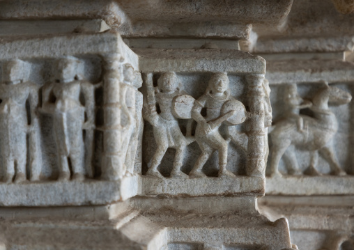 Carved bas relief made of white marble on the wall of Tirthankar jain temple, Rajasthan, Ranakpur, India