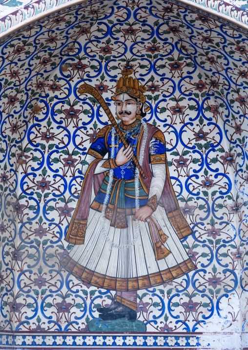 Ancient murals depicting an indian rich man in the city palace, Rajasthan, Jaipur, India